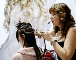 beauticians doing hair extensions